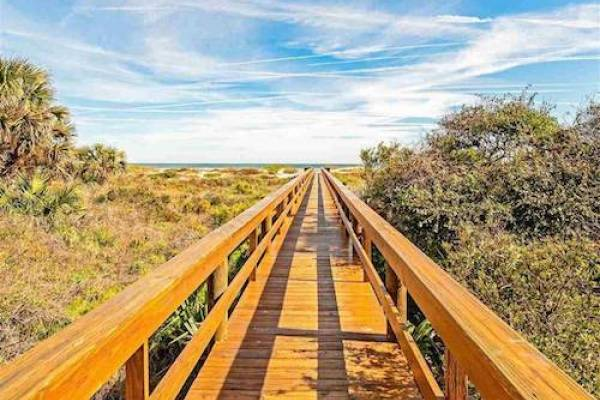 beach and tennis resort boardwalk over sand dunes to st augustine beach
