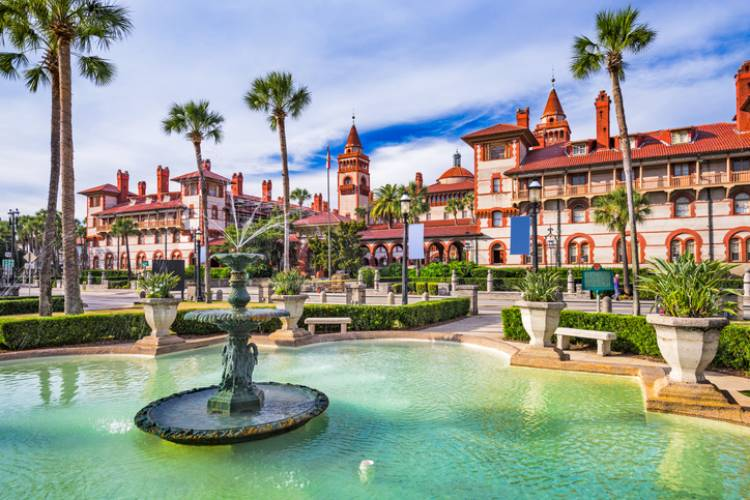 lighner museum in downtown st augustine florida with bright blue water, palm trees and blue skies