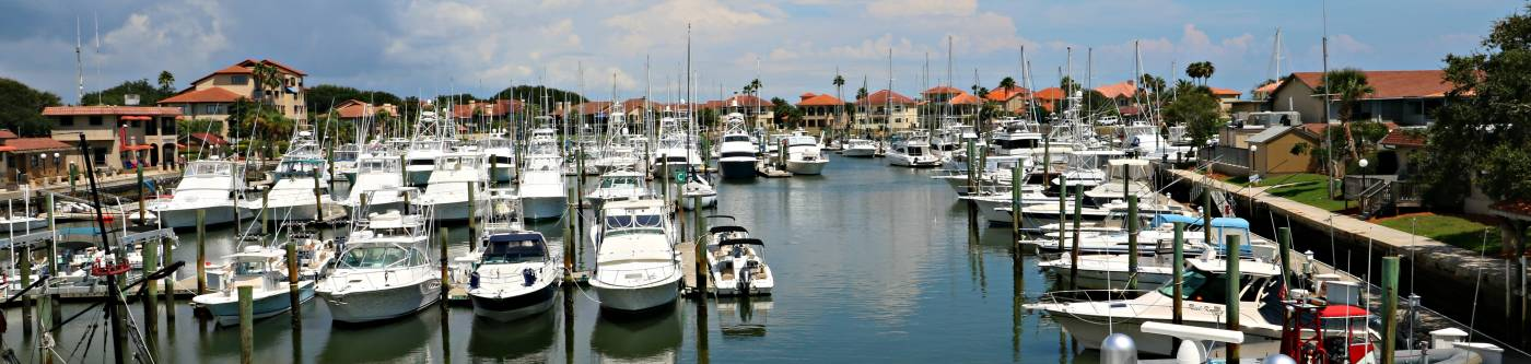 view of camachee harbor at the inn with lines of boats and yachts in the water