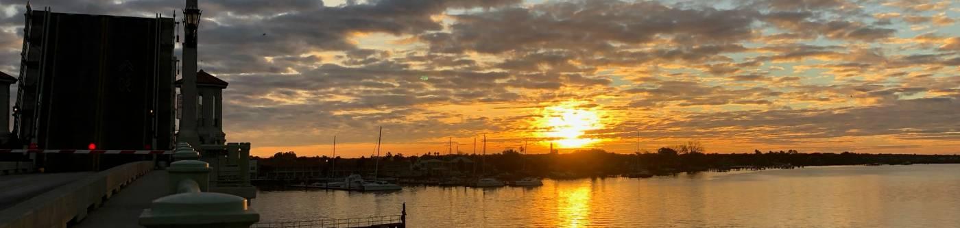 view of sunrise over atlantic ocean in st augustine florida with orange sky