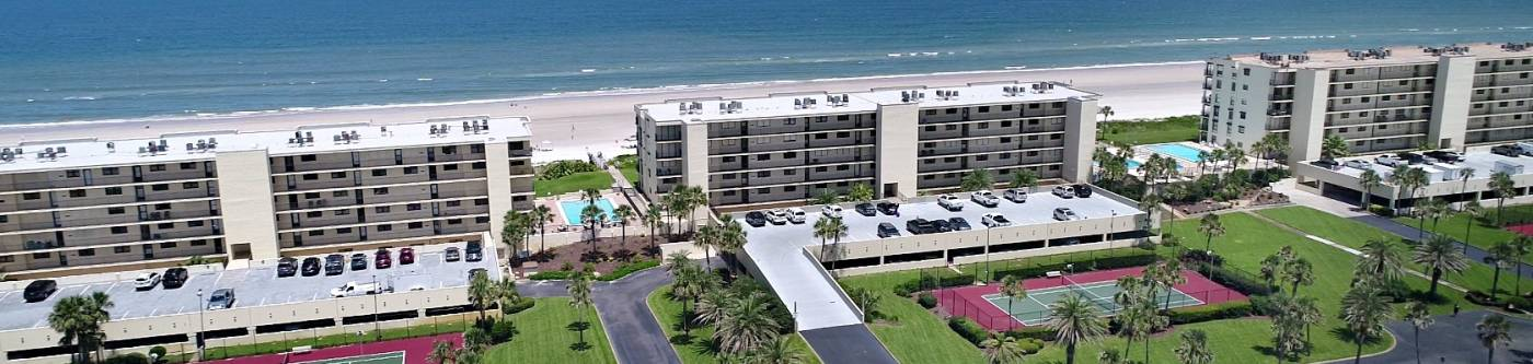 view of Sand Dollar condominiums from the aerial view with the atlantic ocean in the background